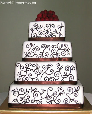 Posted in Cakes Wedding Cakes Tagged cake scroll work piped design on
