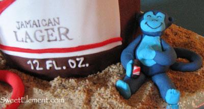Blue Monkey drinking Red Stripe