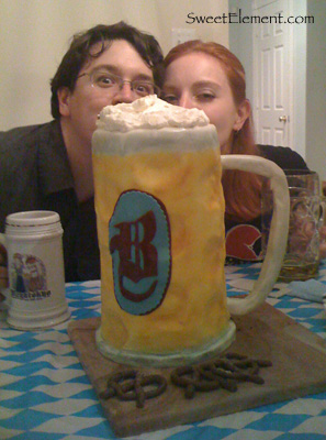 Host & Hostess (& Birthday Girl!) hiding behind the giant beer!